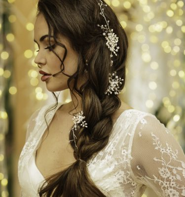Bride with side plait and hair vine