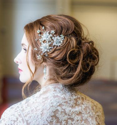 3 bridal pearl and crystal hairpins in a brides hair