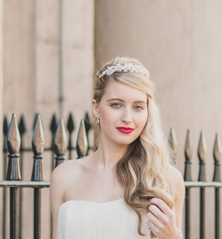 bride wearing a tiara by railings