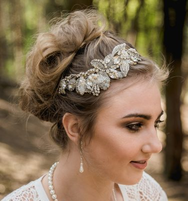 A hand beaded lace wedding headband on bride