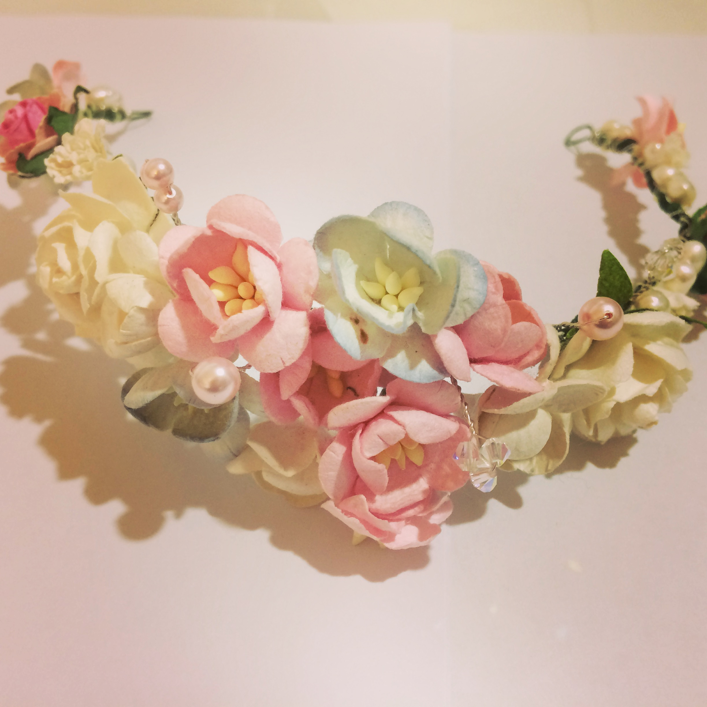 A flower garland with pink and ivory flowers