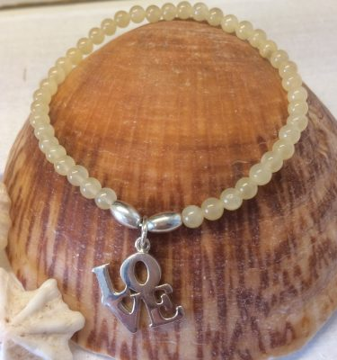Yellow jade bracelet with love charm