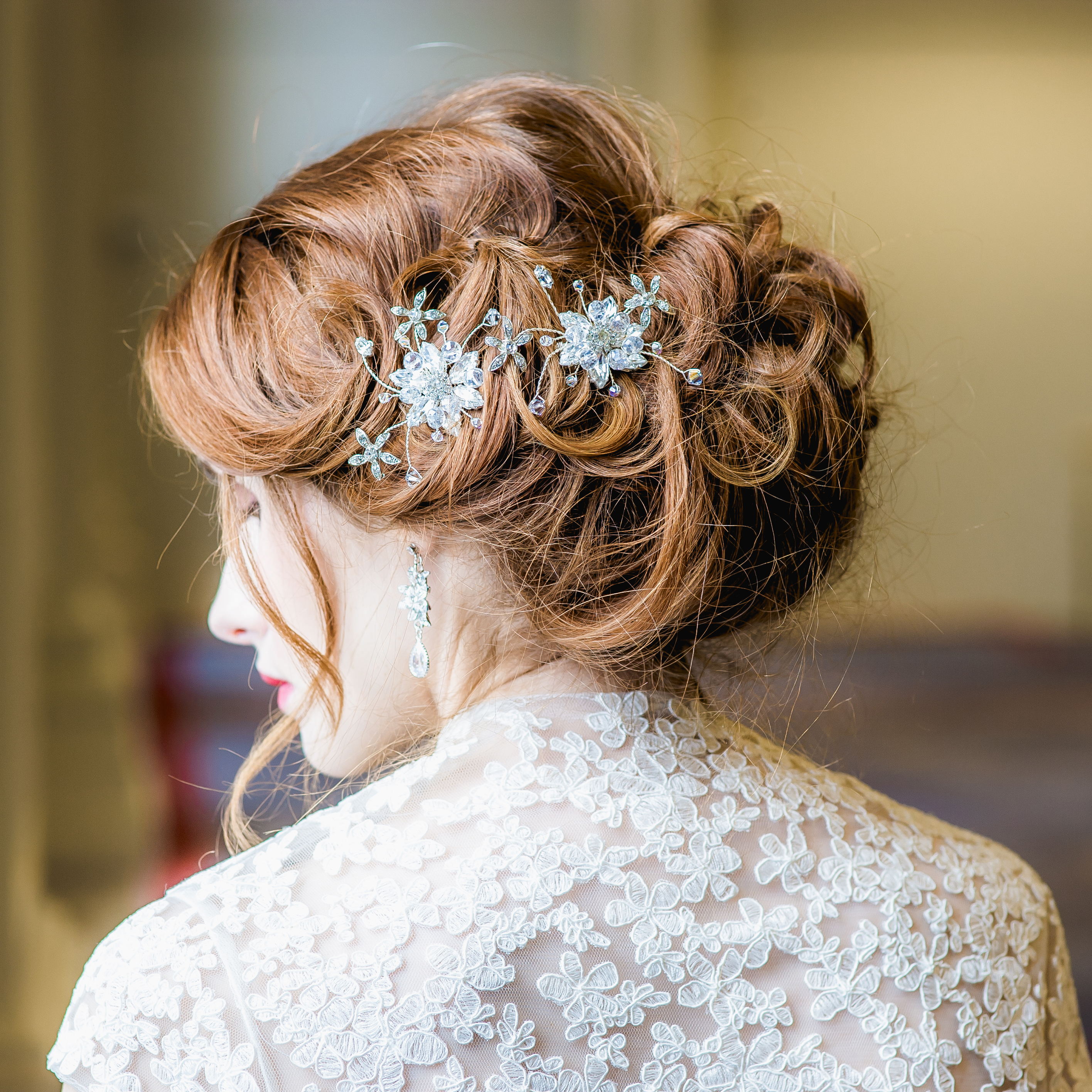 2 crystal flower hair combs on red haired bride