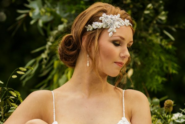 Bride with lace embellished headpiece