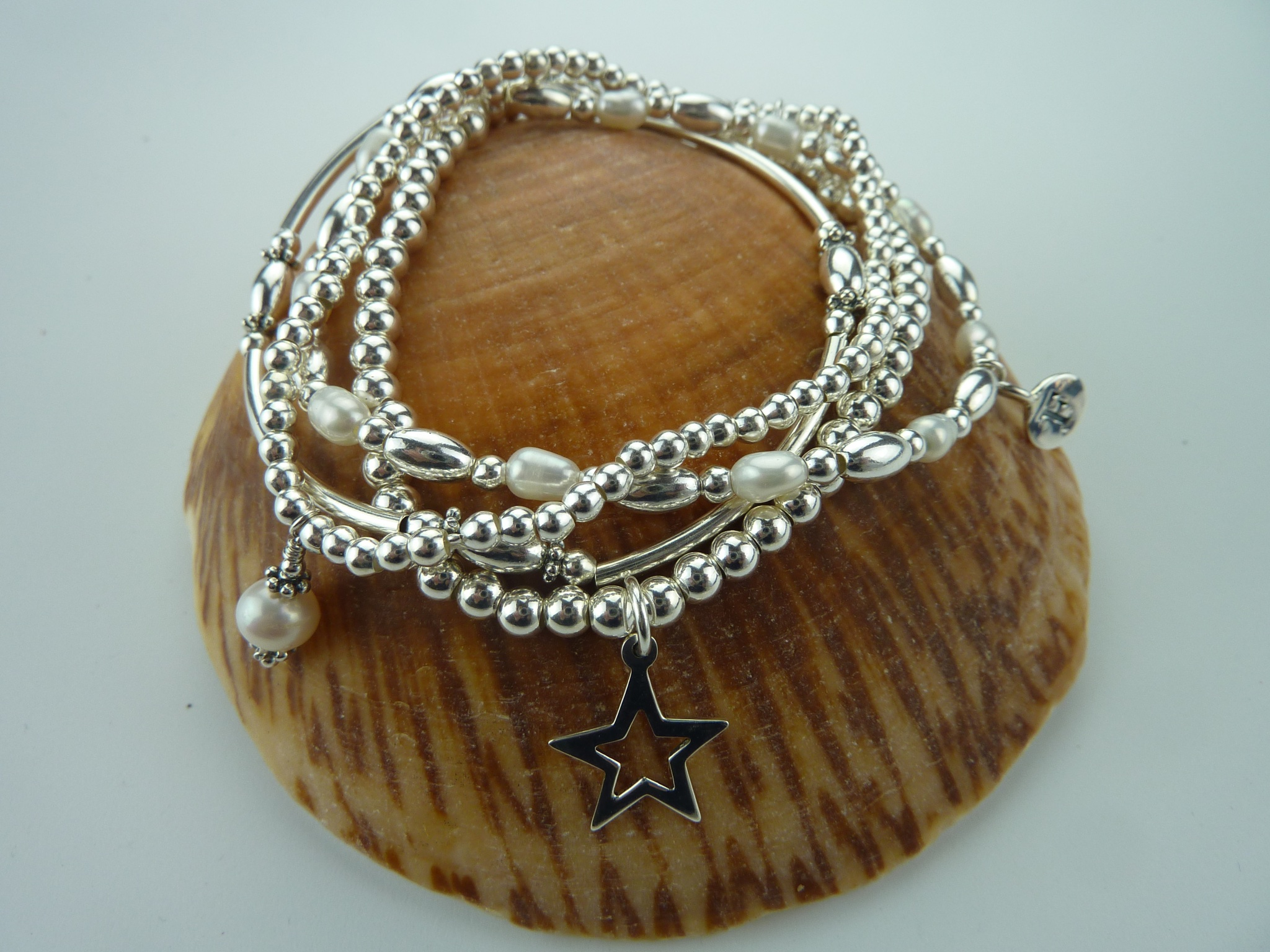 sterling silver bead bracelet with initial charm rocks