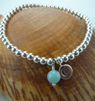 Silver bead bracelet with initial charm and turquoise dangle on seashell
