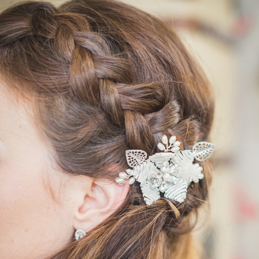Ivory flower comb in plaited hair