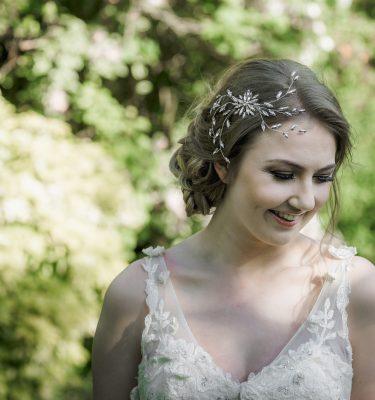 Crystal navette vintage style spray headpiece on a blond bride