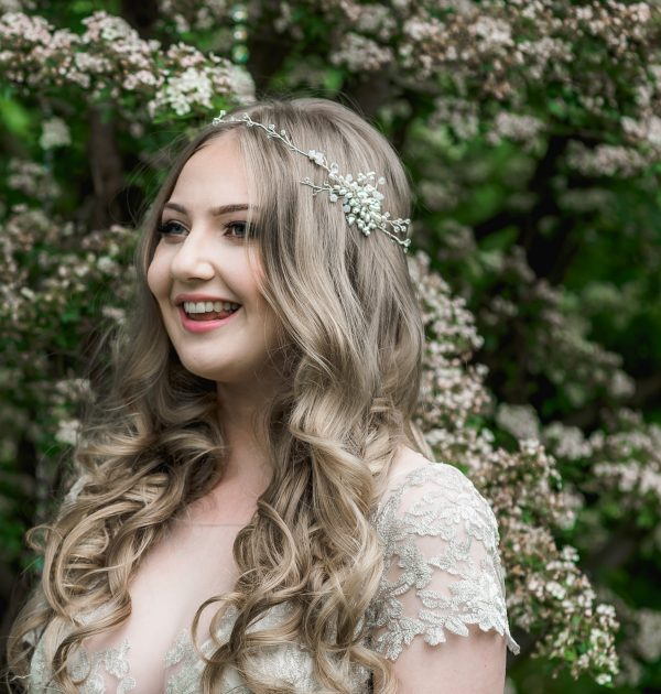 Pearl and crystal bridal hairvine on a long haired bride