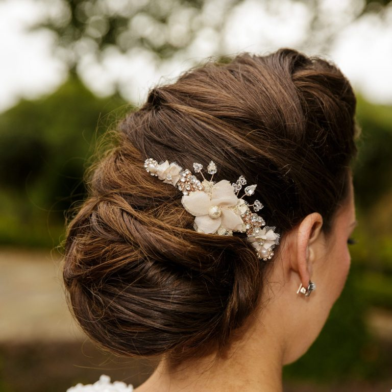 Model with blush pink wedding hair comb