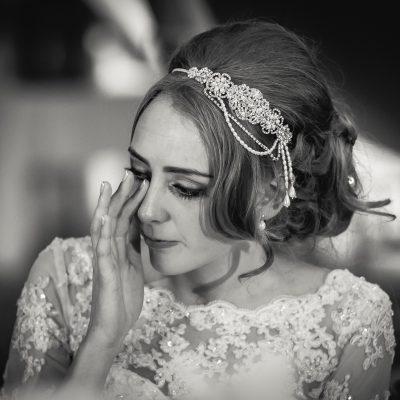 headpiece on crying bride