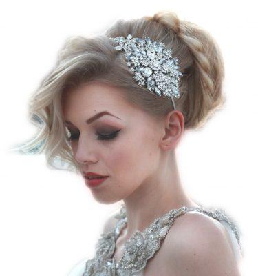 Large crystal headpiece on blond bride