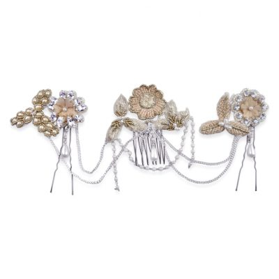 a wedding headpiece in blush tones and 3 combs