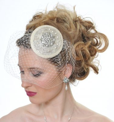 Ivory wedding birdcage headpiece on a blond bride