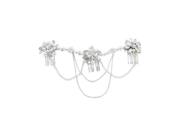 A wedding headpiece with 3 white opal flowers and draped chains