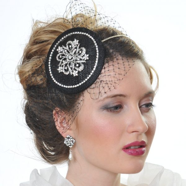 a black wedding fascinator with crystal centre