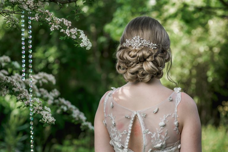Pearl and crystal bridal hairvine on blonde bride with hair