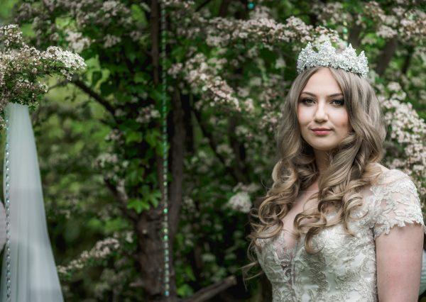 Bride wearing a large crystal wedding crown