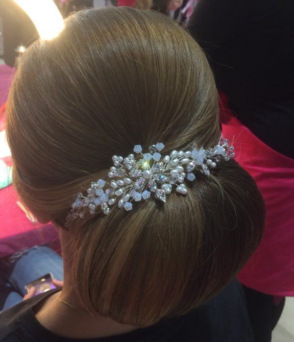 Crystal and pearl vine comb on an updo