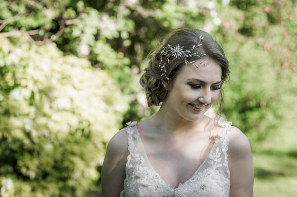 Crystal navette vintage style spray headpiece on a blond bride