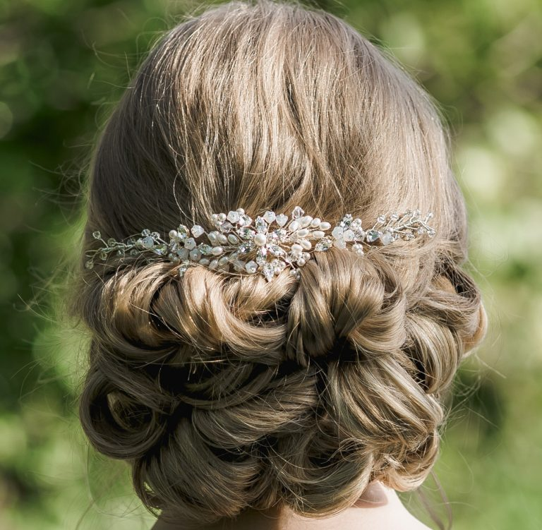 Pearl and crystal wedding hairvine on bride with hair up
