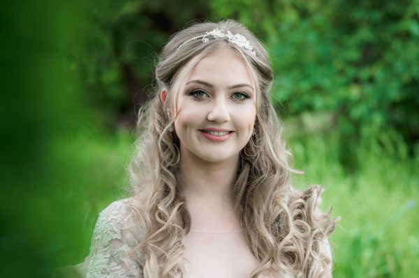 blush and crystal flower headpiece on blonde bride with long hair